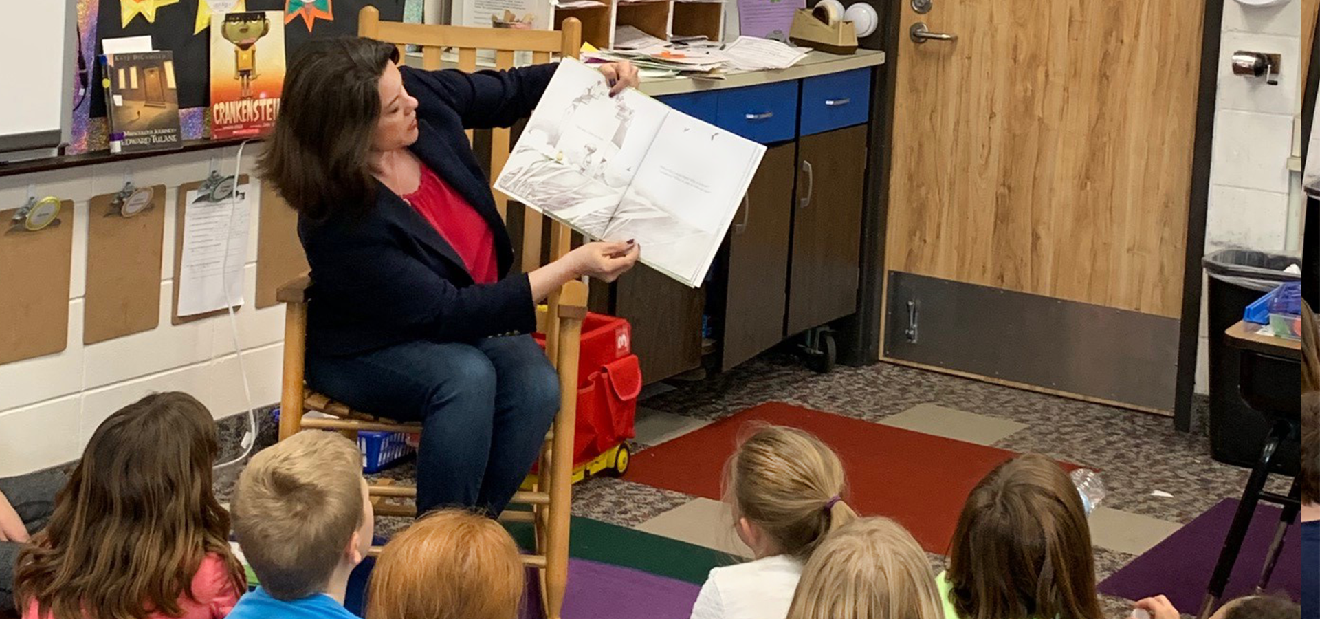 Rep. Craig reading a story to children