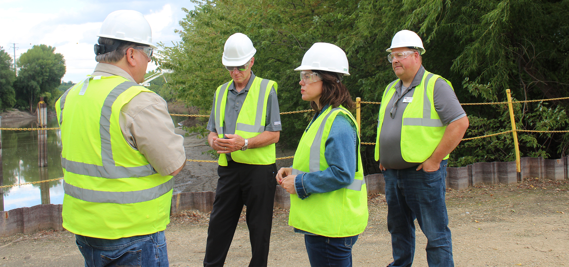 Rep. Craig talking with a group of workers